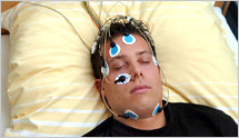 a man with his eyes closed, with electrodes on his face