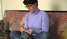 Woman knitting on the couch