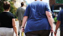 Overweight woman walking